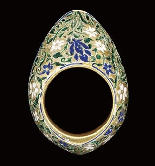 A green and blue enamelled silver gilt archer's ring, Lucknow, India, c. late 18th century