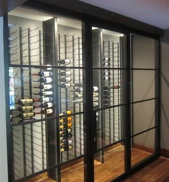 Glass Walls And Metal Custom Wine Racks Create A Contemporary Wine