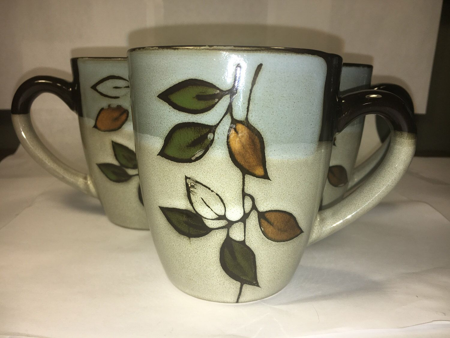 A personal favorite from my Etsy shop https://www.etsy.com/listing/511199567/pfaltzgraff-lot-4-rustic-leaves-mug-cup