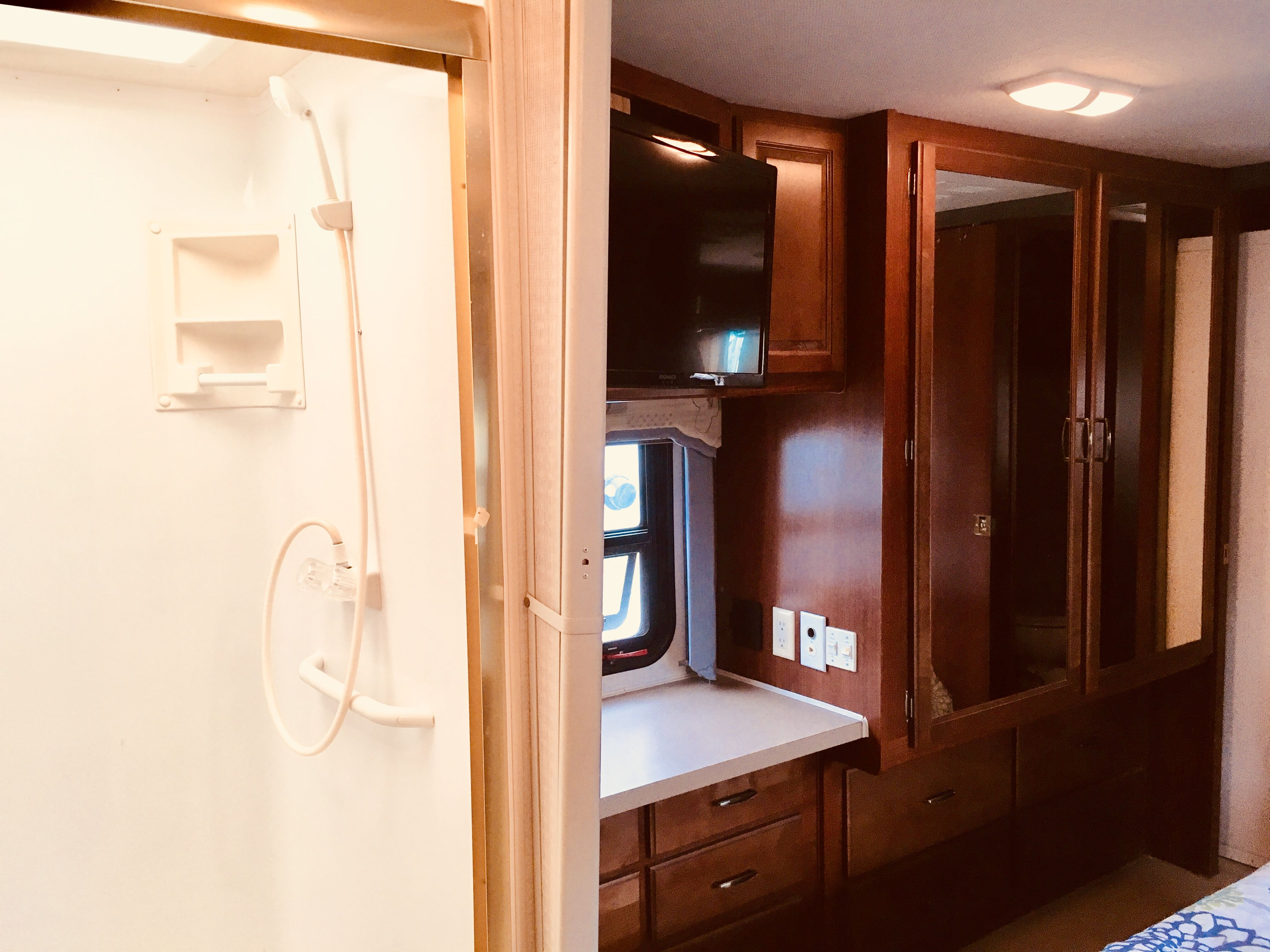 Skylight in shower and overhead vent above vanity plus two