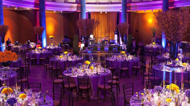 Wedding Reception Bathed In Orange And Purple