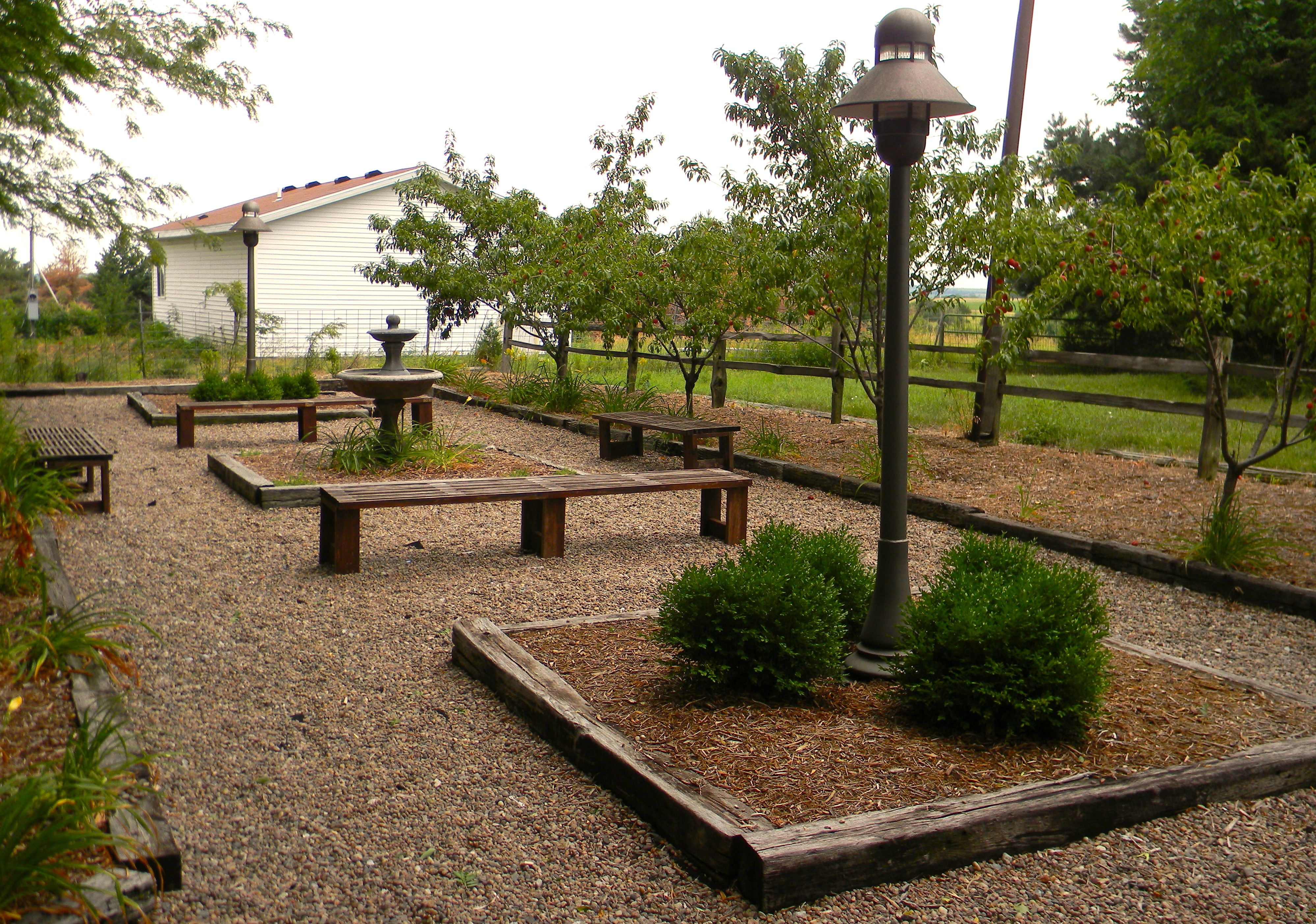 Fountain in raised garden area at Country Pines- Lincoln, NE ...
