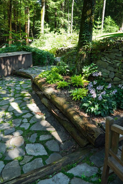 Raised garden bed in shade under trees with stone patio - What to put under raised garden beds ...