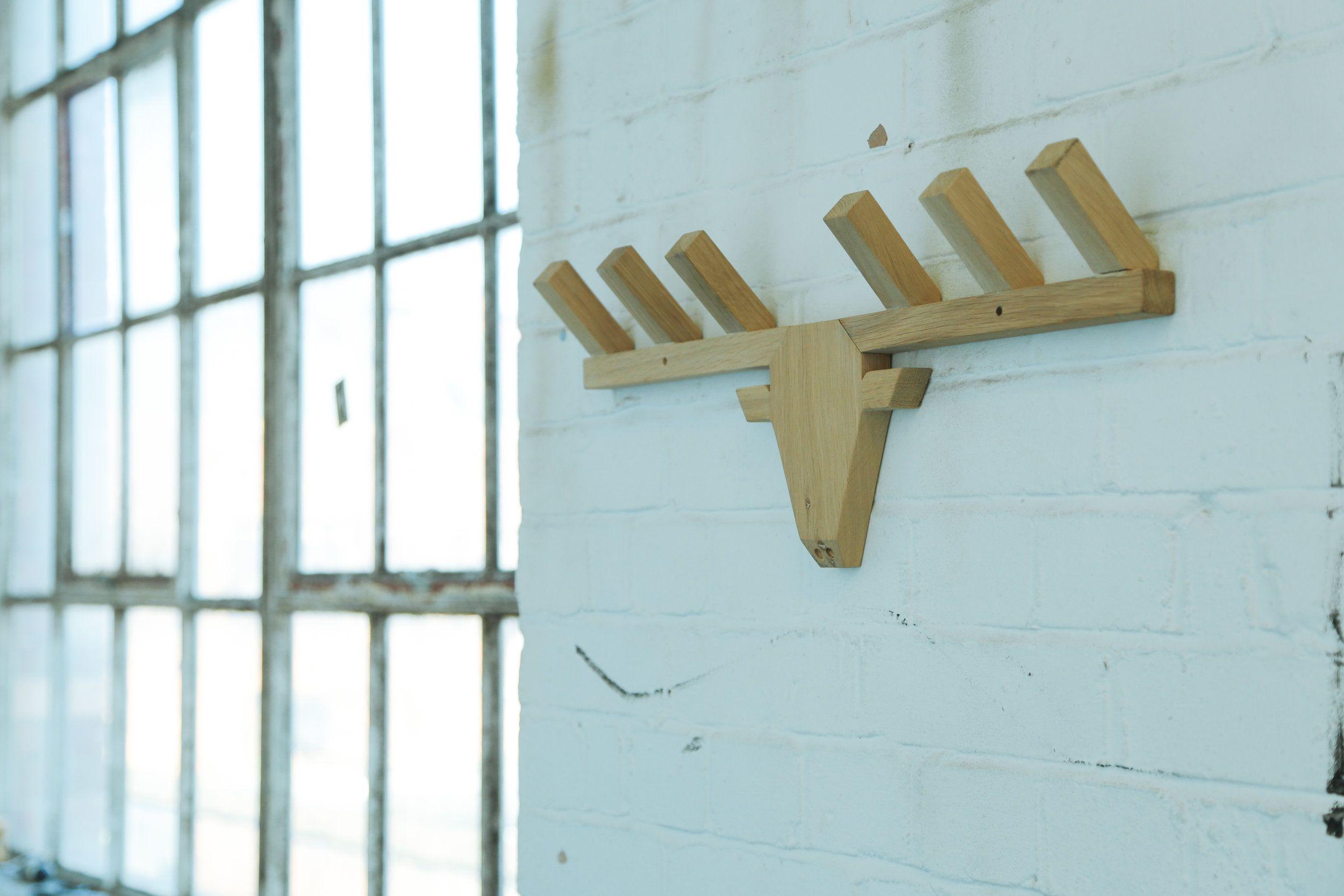 The Caribou | Geometric designs, Coat racks and Wood walls