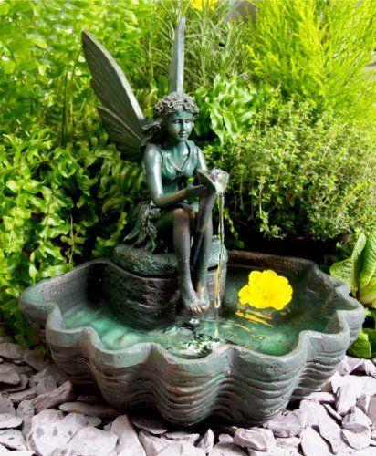une jolie fontaine solaire pour jardin