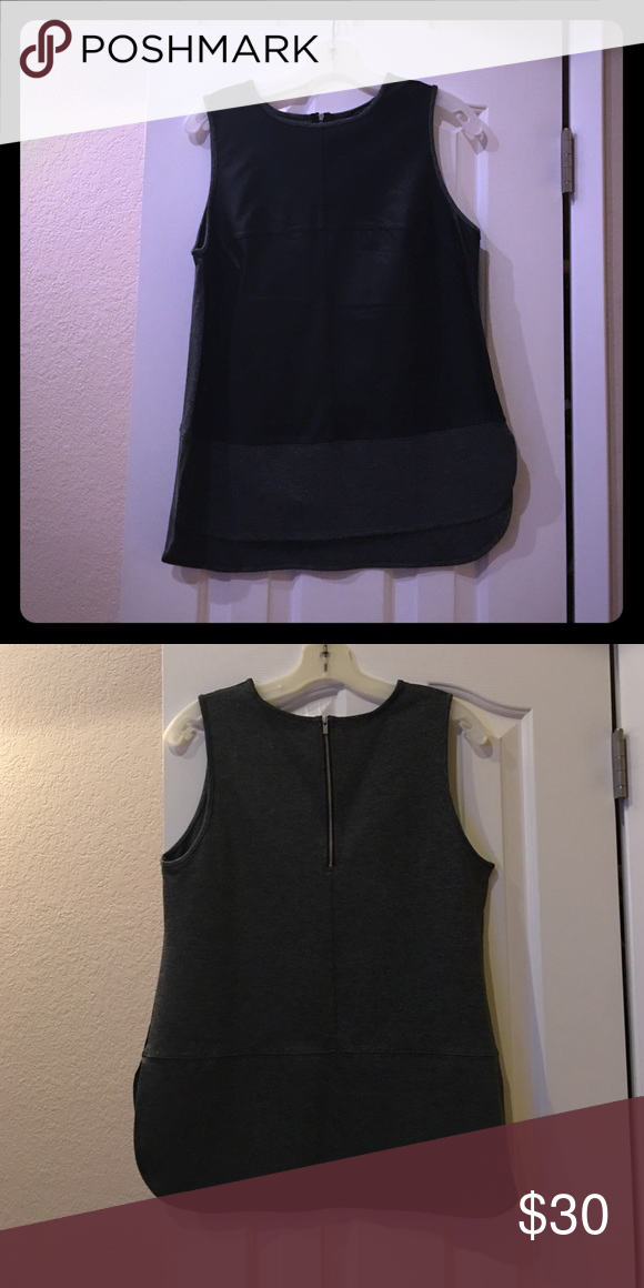 Banana Republic mixed media top Worn once. Faux leather front. Zipper in back. Longer in back with slits on sides. Sz. M Banana Republic Tops