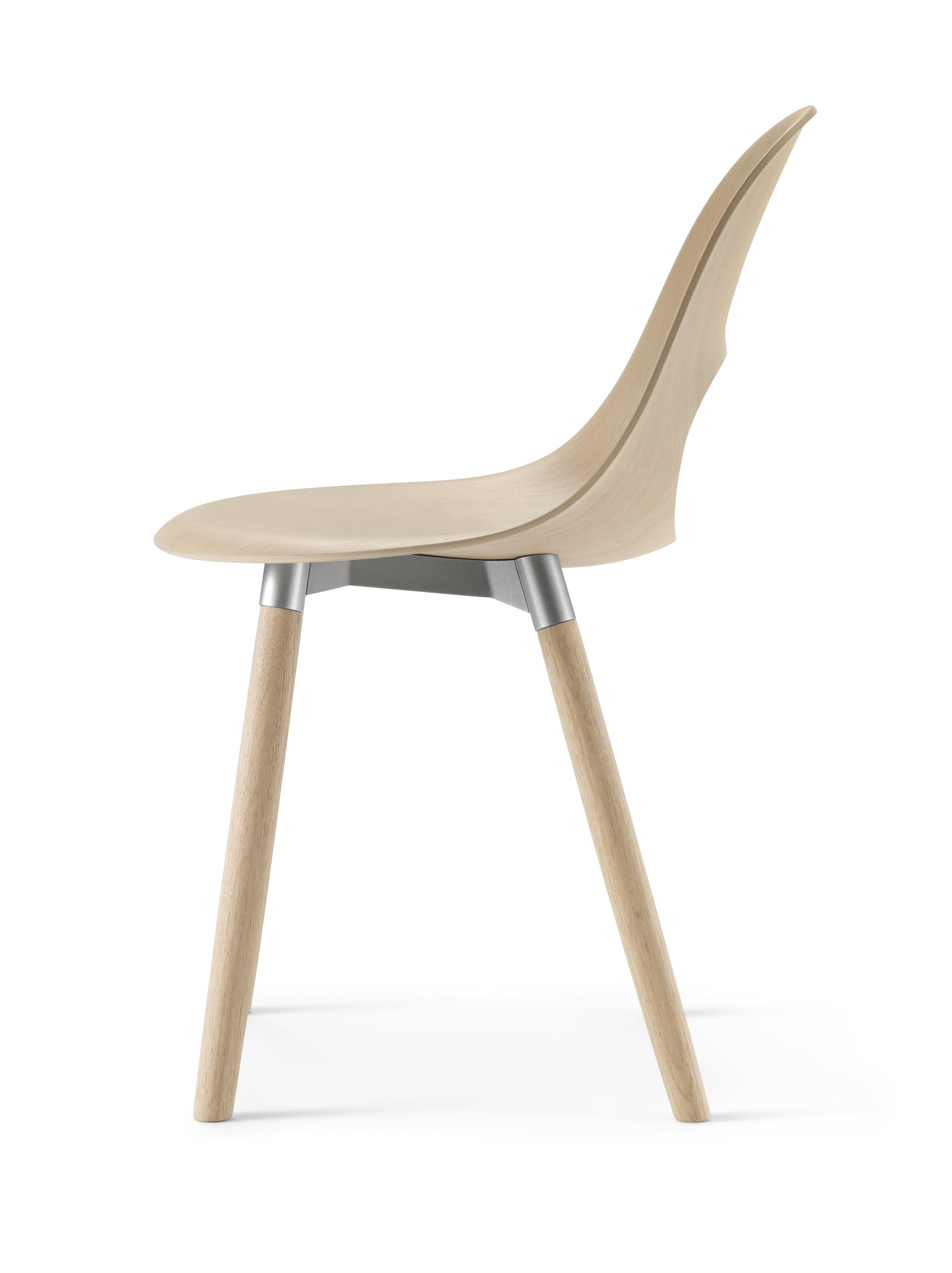 This beautiful SayO Chair in raw wood with and wood legs seen in profile. May be acquired with different types of wood veneer. Find out more at www.sayo.dk.
