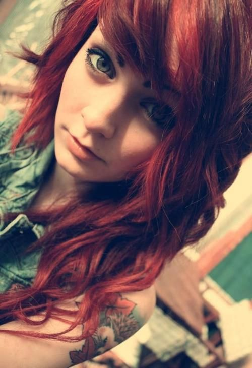 Red hair, with curls.
