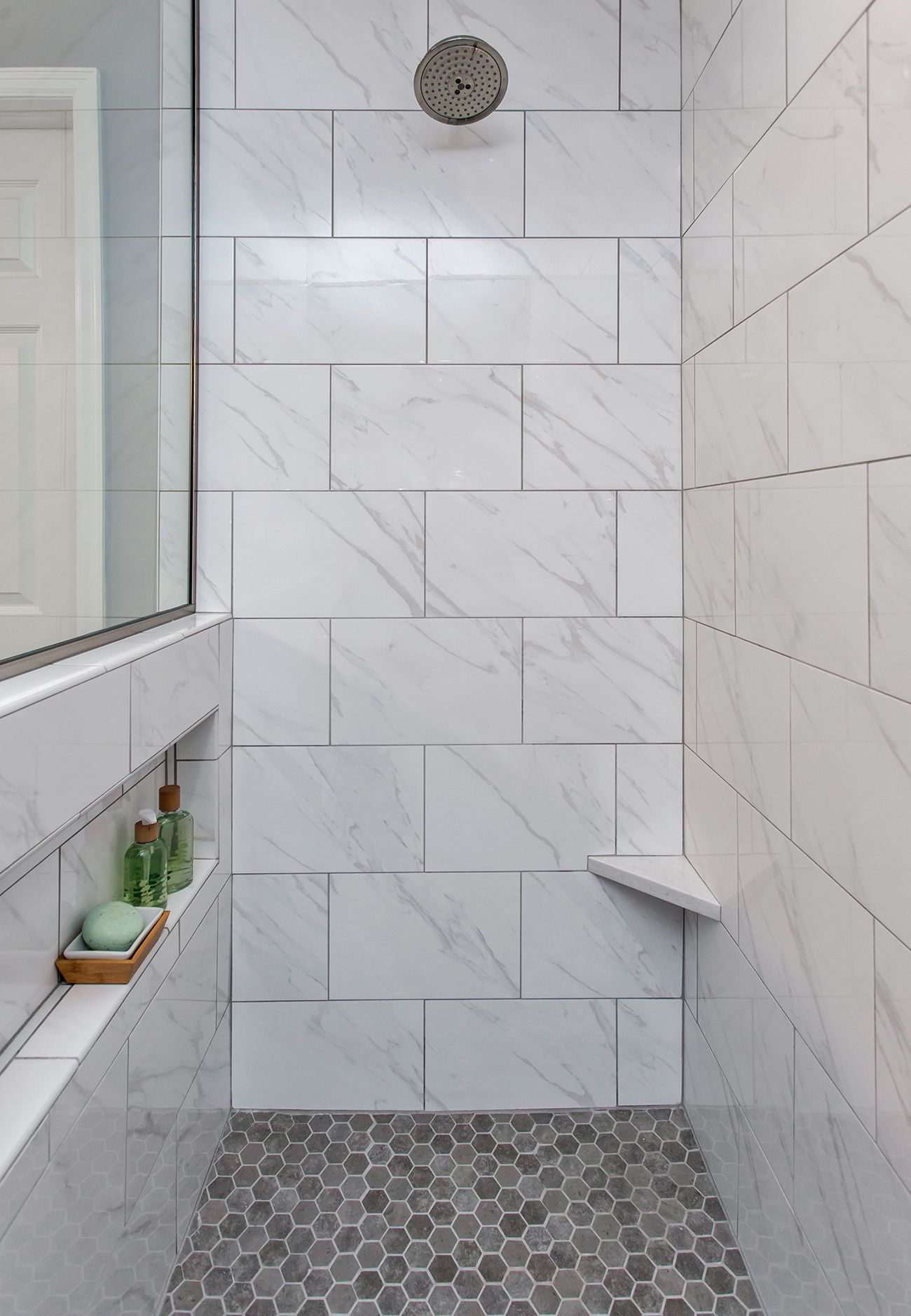 This marble shower has a niche that s invisible from the outside maximizing a clean