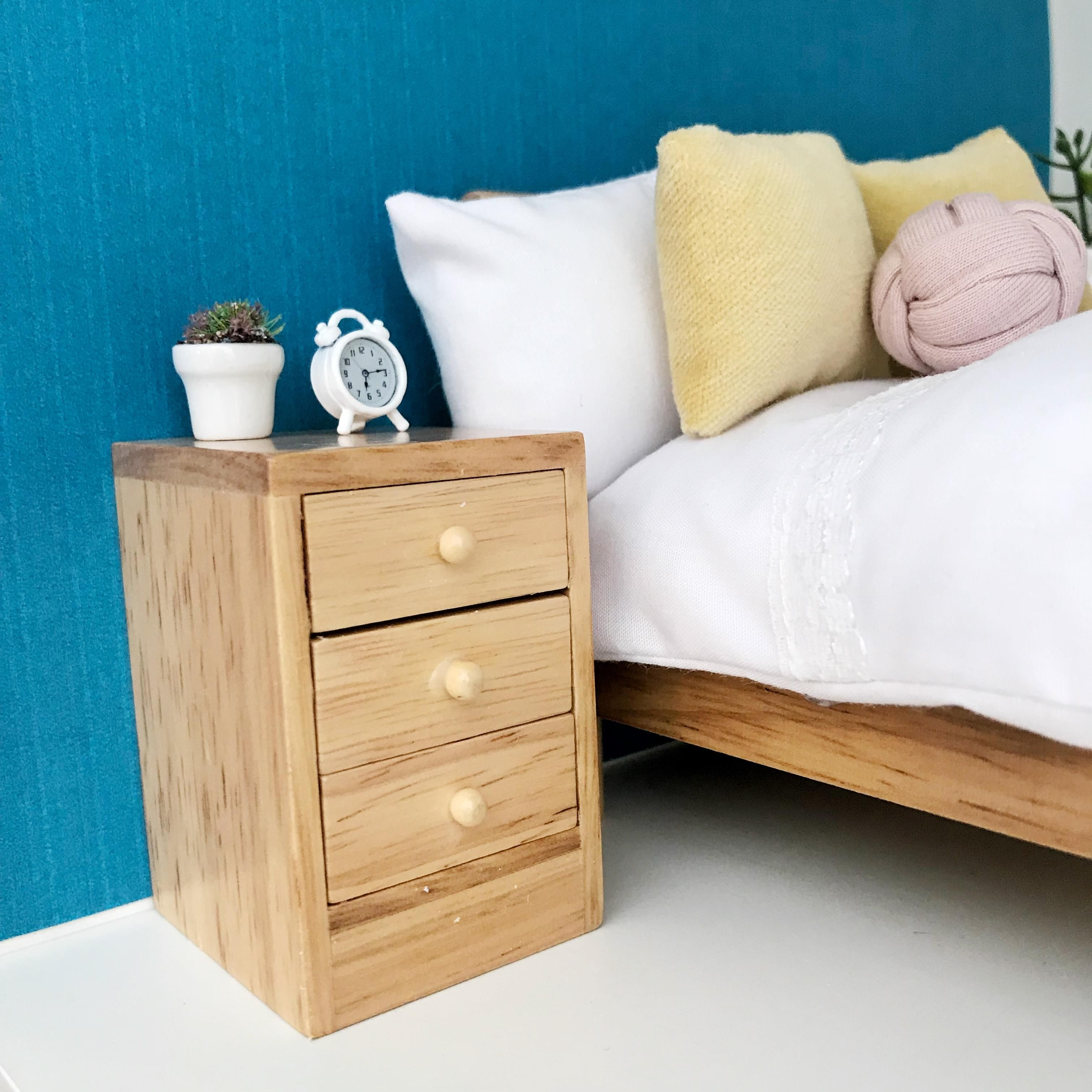 Single Light Wood Bedside Table With 3 Drawers The Drawers Open