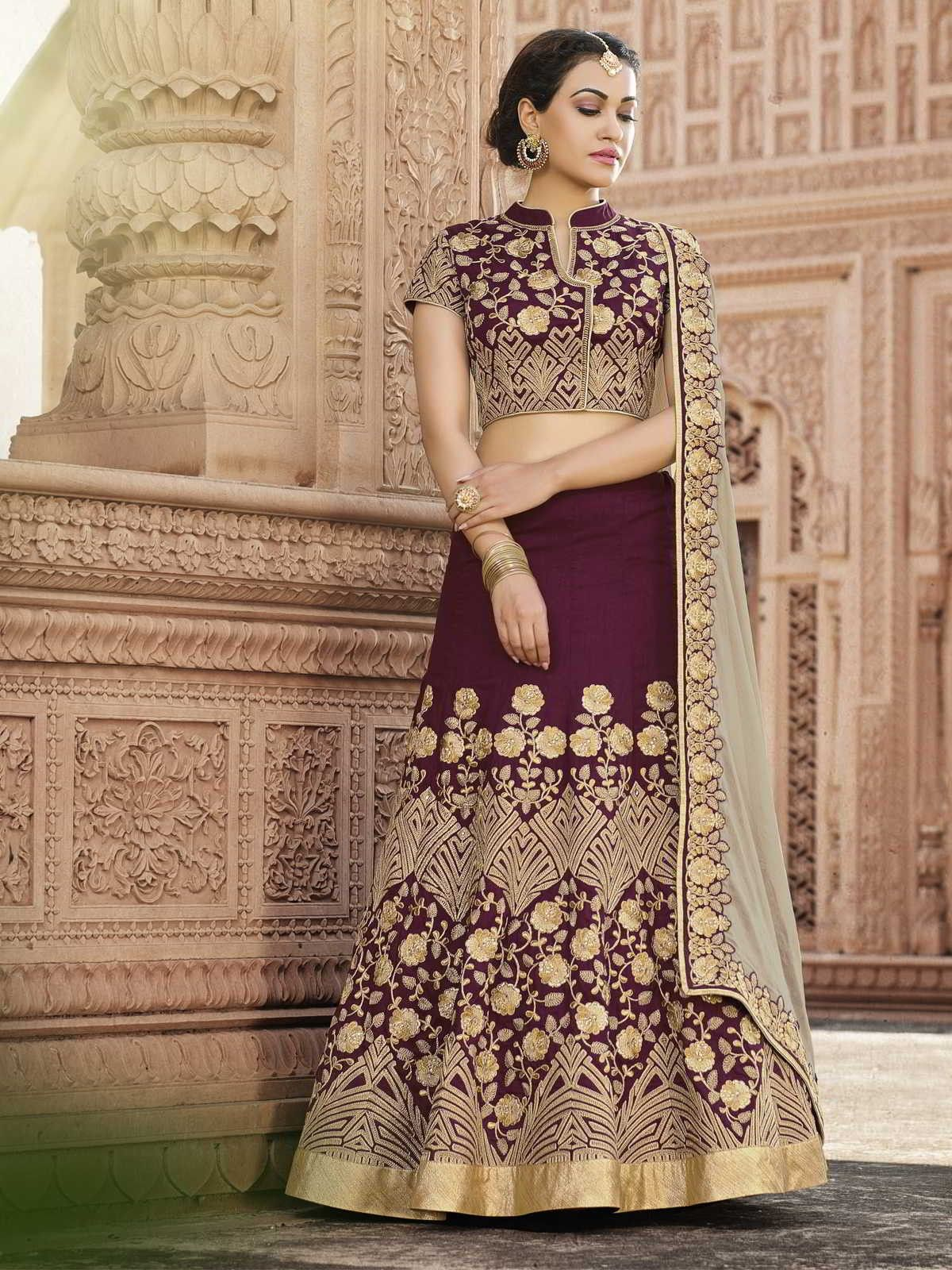 7da8cf7faf Charming maroon embroidered partywear lehenga choli online which is crafted  from silk and net fabric with exclusive embroidery and stone work.