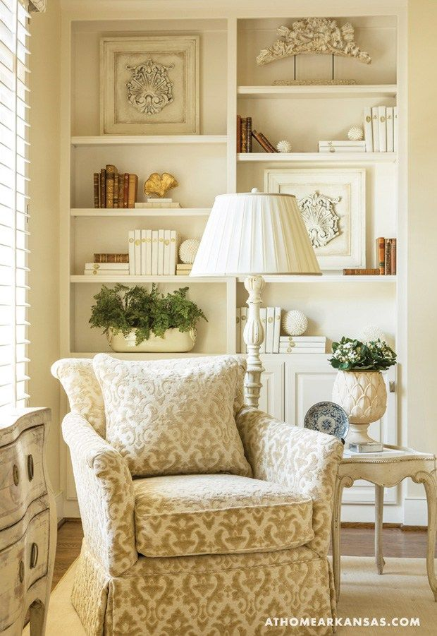 Cozy reading nook in traditional living room library - How to decorate shelves in living room ...