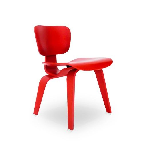 a chair designed by the couple charles ray eames bent plywood in