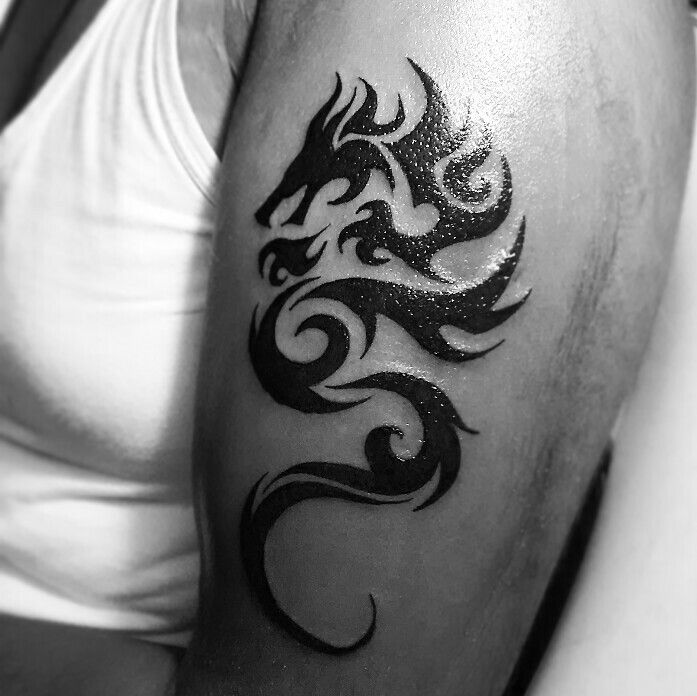 1b3e586c1 Tribal Dragon Tattoo By Bhavesh Kalma Ahmedabad India #tattoo #design #ink  #inked #inkedmag #black #simple