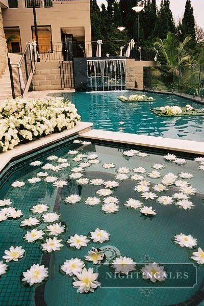 flowers in fountain/pool   Pool wedding, Backyard wedding ...
