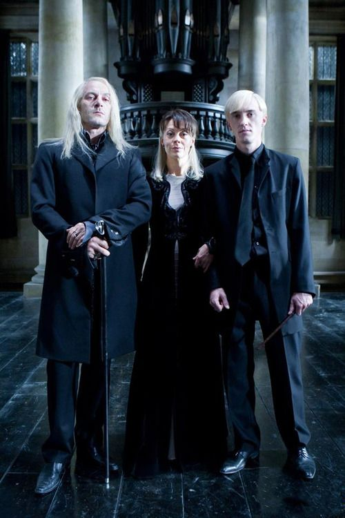 Lucius, Narcissa, and Draco Malfoy. I was able to take a picture of the family with a Muggle camera. Lucius and Narcissa were so stressed out they didn't even notice; but Draco knew. He winked at me after I took the picture.