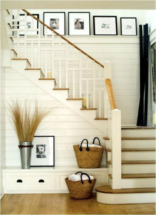 Cottage-style entryway in warm whites with touches of black...  Behold:  the planked entry wall.
