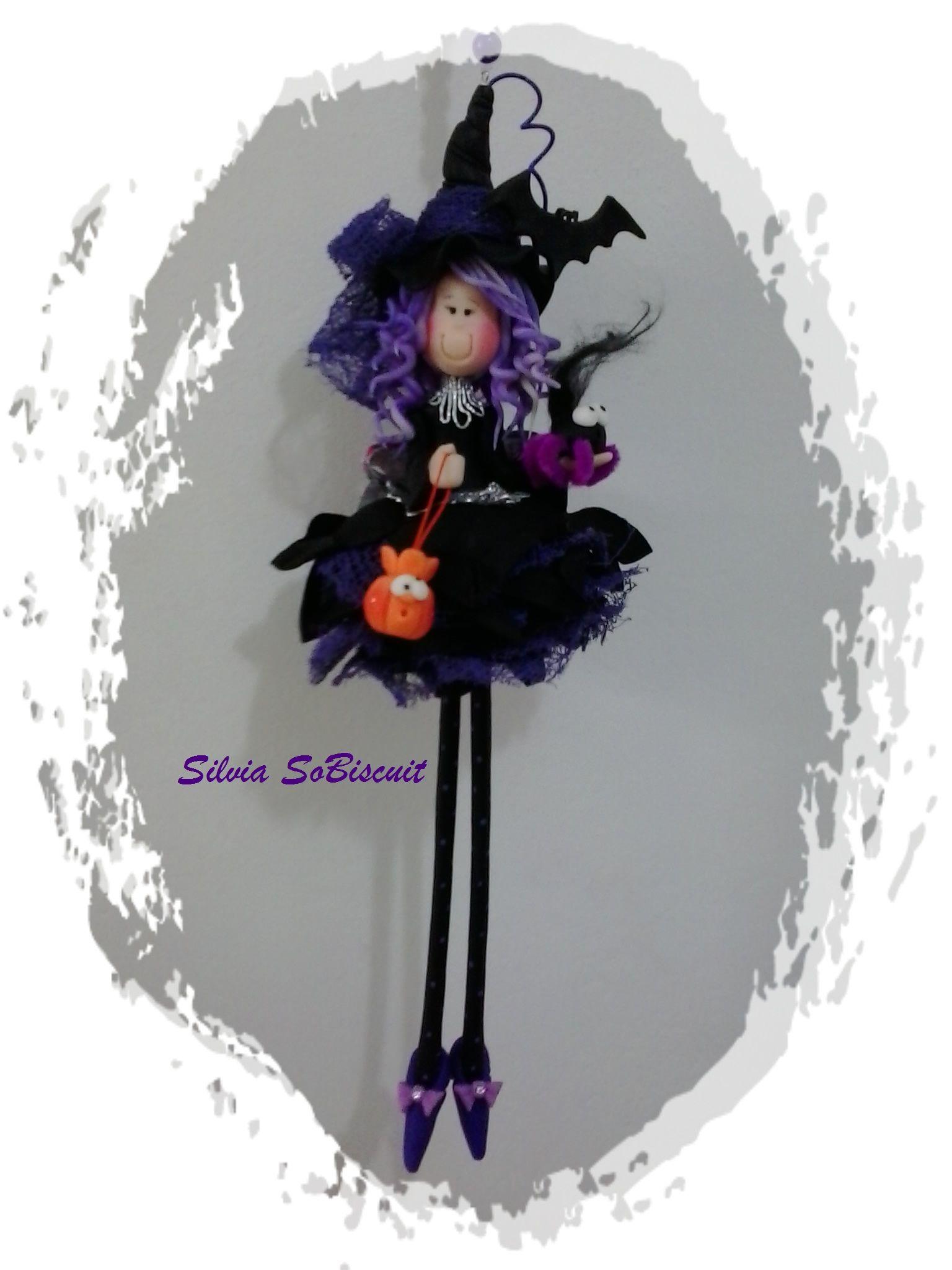 Minha Bruxinha lilas.  My lilac which.minha criação , feito com biscuit e flor artificial