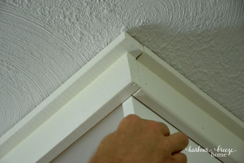 Adding moulding to ikea billy bookcase ceiling trim