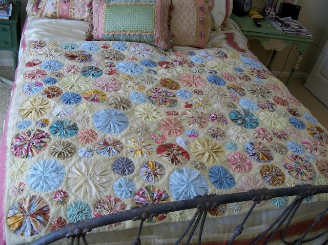 I made this quilt for my mom this last Christmas. After making all the yo-yos, I sewed them on by hand. I think that gives it a really an...