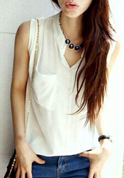 Model in white button-down sleeveless shirt with a cute pose