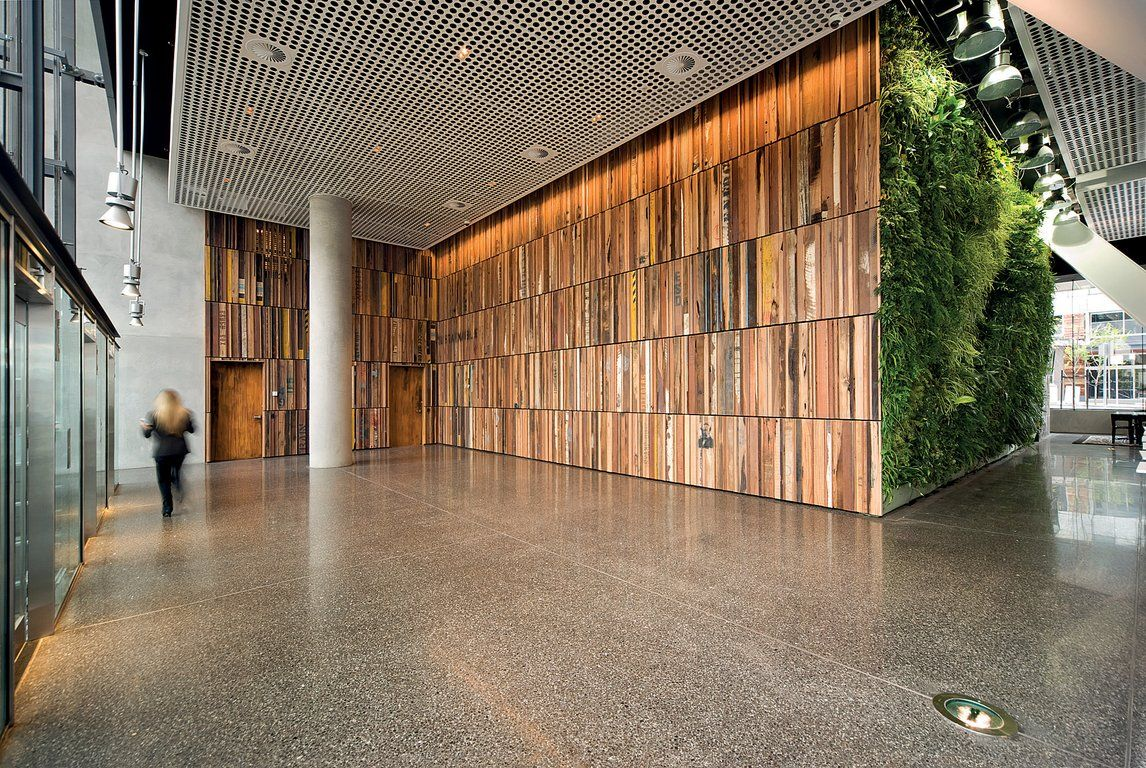 Recycled timber wall cladding the gauge docklands lend lease interior design hotel for Wooden cladding for exterior walls
