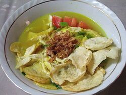 Soto ayam, a spicy yellow chicken soup commonly found in both Indonesia and Singapore.
