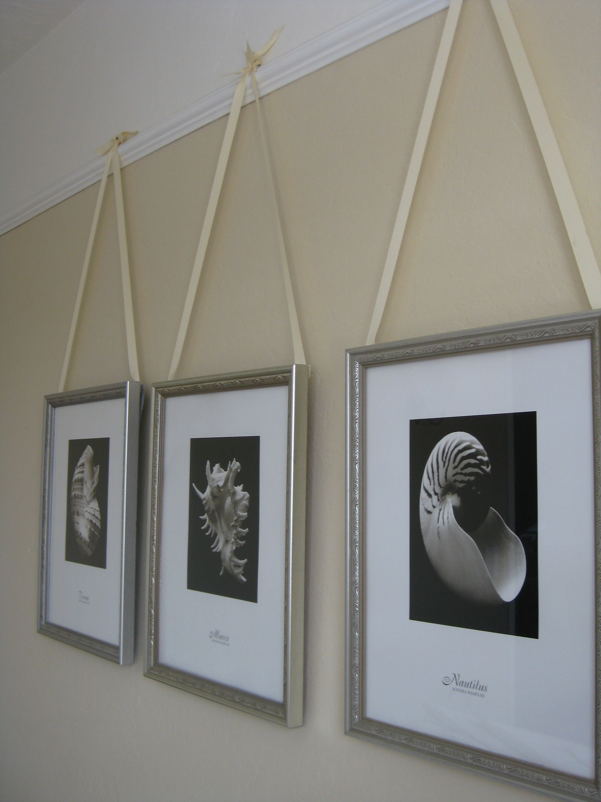 Decorative way to hang pictures! I painted our guest room ...