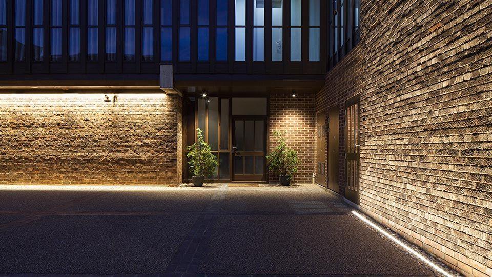 Nulty   Baylis Old School, London   Fenestration Detail Exterior  Architectural Lighting Stark Walls Energy