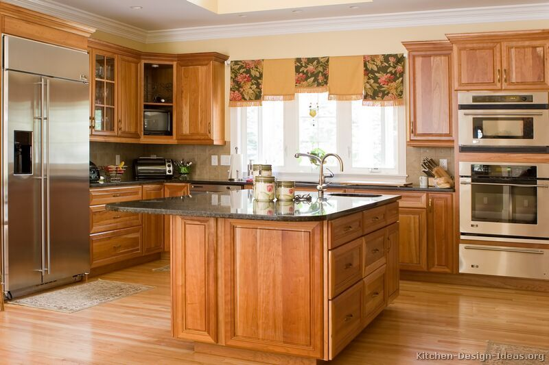 I like this combo medium golden cabinets with lighter wood floor ...