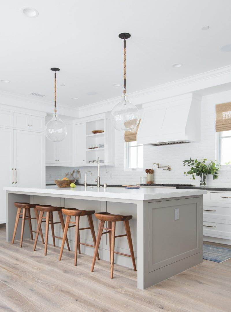 A Minimal Neutral Interior Design For A An Open Kitchen Concept Amber Interiors White Kitchen Design Kitchen Designs Layout Kitchen Design
