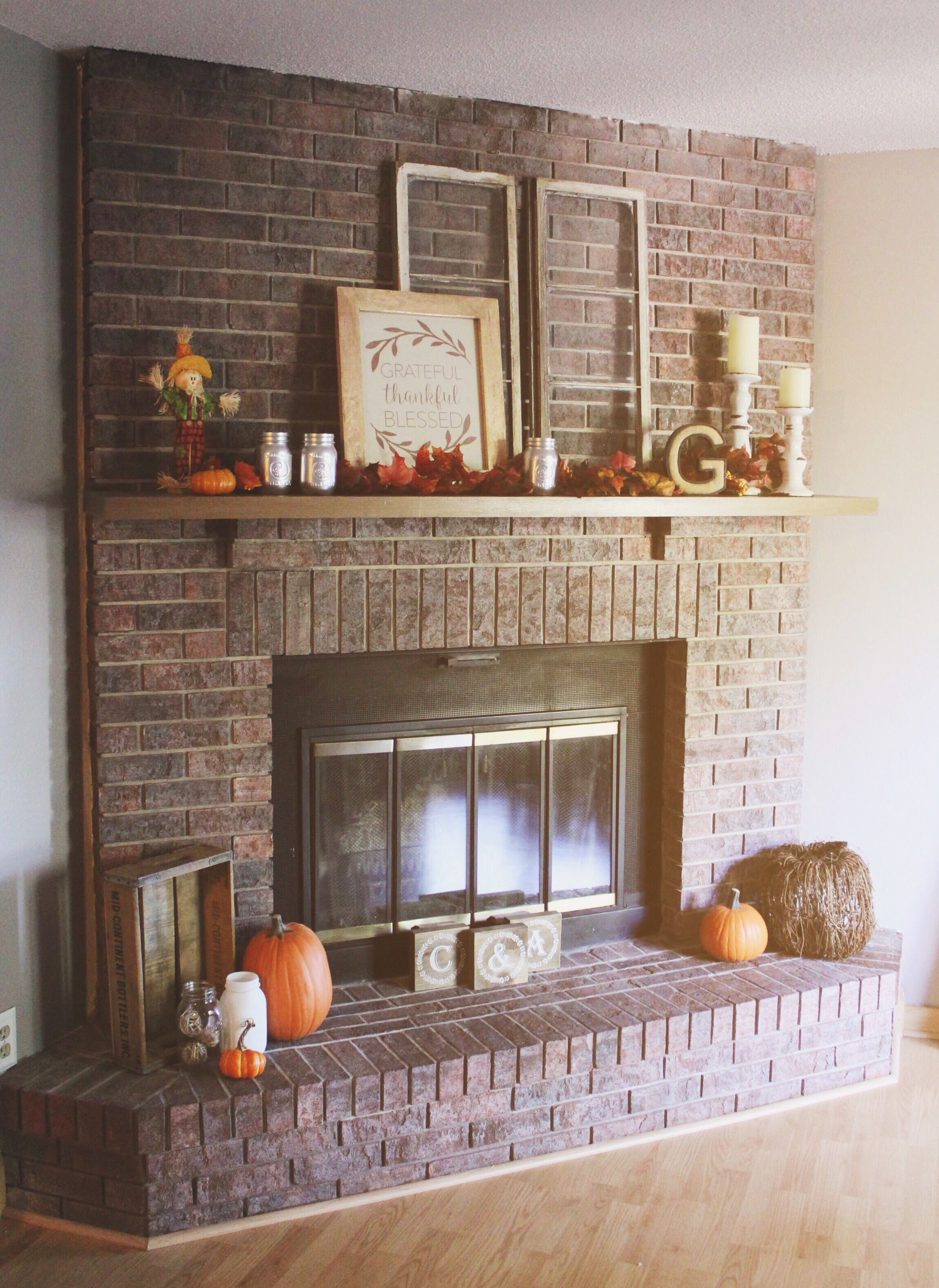 Our cozy rustic chic fall red brick fireplace mantel decor Brick fireplace wall decorating ideas
