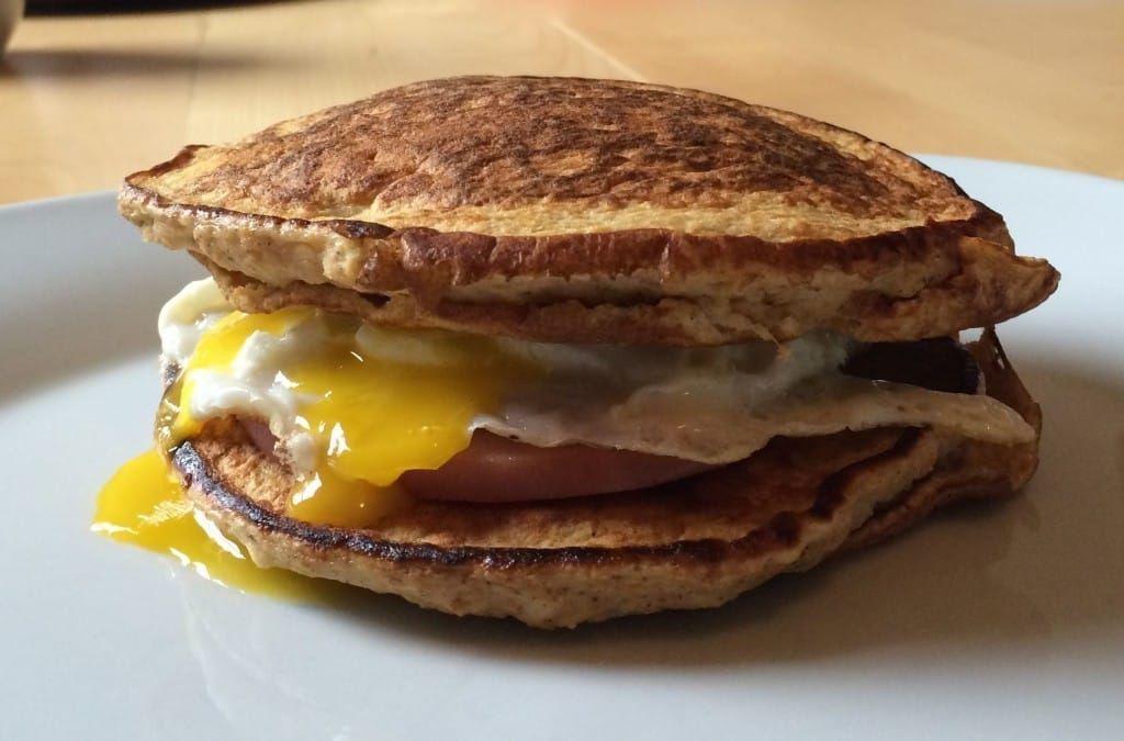 Bacon and egg sweet potato pancake breakfast sandwich