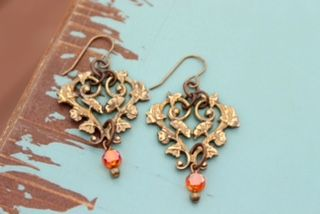 Golden Vines - Hand painted with a gold patina - the brass is then rubbed to relief the vine design. A Swarovski crystal dangles from the vine.  Available in assorted colored crystals.