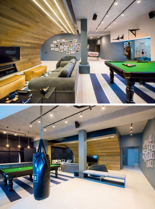 Photo of This basement designed for a teenager features a wooden wave a bar/snack area a …