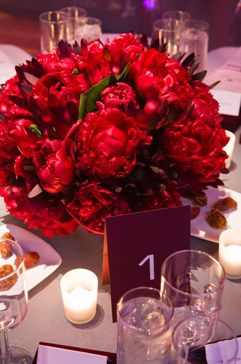 Pair bold red peonies with a gray tablecloth for more masculine décor.