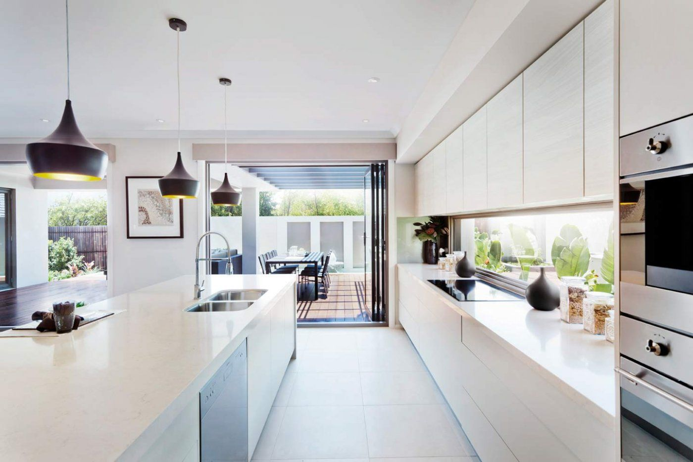 window used as a splashback! Also nice style of handle-free ...