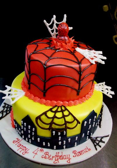 A two-tiered red and yellow Spiderman cake. | Novelty ...