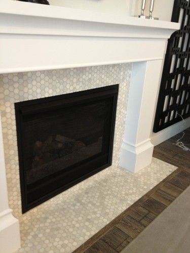 what our fireplace would look like with the carrerra penny rounds Cast  Fireplace Surround, smooth finish, painted white with tiles.