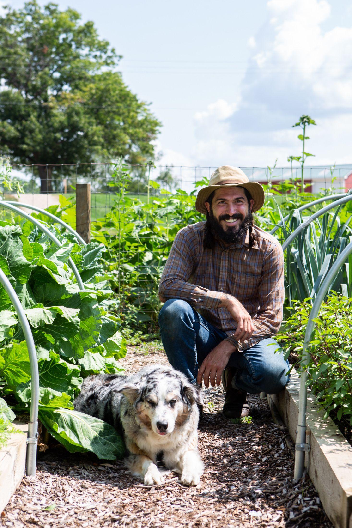Farmer Stephen Lamberti and his dog at Zingerman's Cornman Farms in Dexter, Michigan.