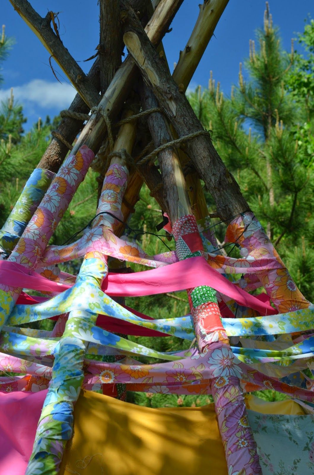 So here is our finished teepee…made entirely out of recycled bedsheets and cedar poles      I will try to explain the process below    is part of Fabric teepee -