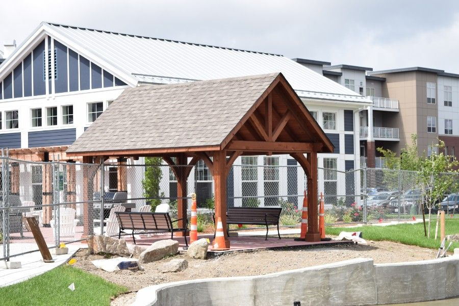 This wood stained pavilion features an A frame roof
