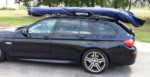 Nesting, Portable, Folding Boats & Dinghies UK - Nestaway Boats Ltd - NAUTIRAID Folding Boats - Above: Folded Coracle C300 (10ft version) on roof, with optional hull bag. Upside down, the curved folded shape at the bow fits neatly with the slope of many hatchback and estate cars.