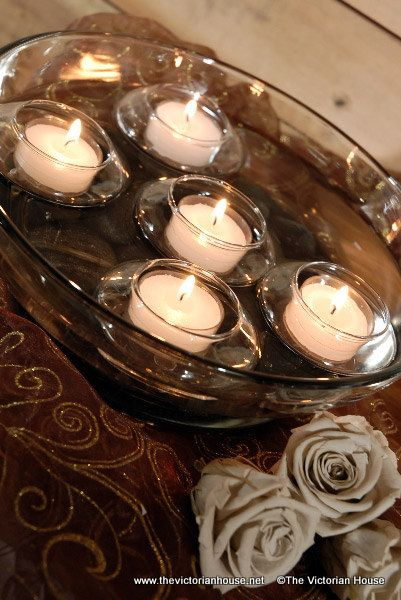 Have A Big Bowl And Float Candles On The Top. Put A Vase In The Bowl To So  It Is Like And Island. Note: Most Tea Light Candles ...