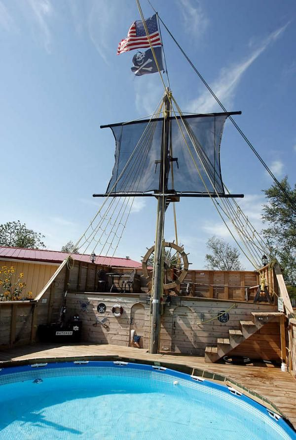 Pirate Ship Next To The Pool With A Plank For The Diving