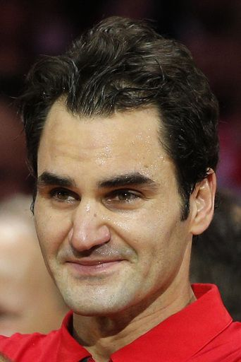 Swiss players Roger Federer shows his emotion after defeating France in the Davis Cup final at the Pierre Mauroy stadium in Lille, northern France, Sunday, Nov. 23, 2014.  Switzerland won 3-1  and wins the Davis Cup. (AP)