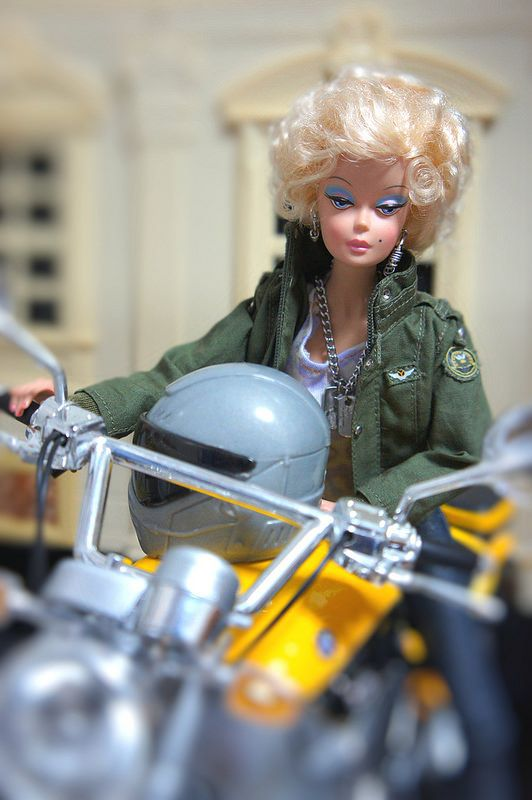 Barbie rides a motorcycle