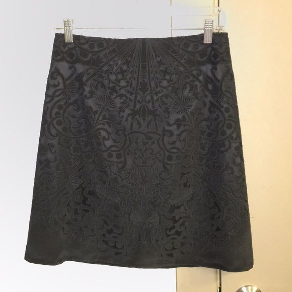 {NWT} Eli Tahari Black Skirt Gorgeous black skirt for work or a night out. Never worn, tags from Bloomingdales still attached. Stitching on tag coming off - see photo, no damage to skirt itself. 100% silk. Fits true to size. Elie Tahari Skirts A-Line or Full