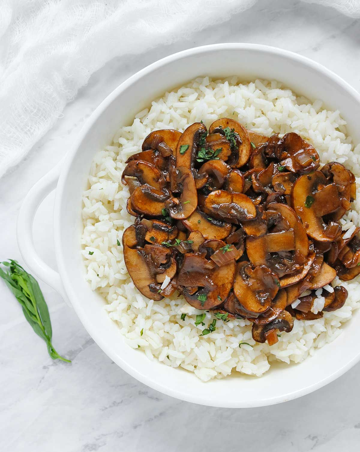 Balsamic Mushrooms with Tarragon Rice -  rich, meaty, cremini mushrooms sauteed in butter with a sweet balsamic glaze, and served over tarragon-accented rice. -   SoupAddict.com   vegetarian