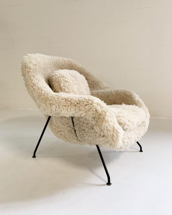 Knoll Saarinen Womb Chair One of the most iconic and comfortable  hygge chairs of the modern furniture movement, the womb chair was born from Florence Knoll's request for Eero Saarinen to create her a chair that she could